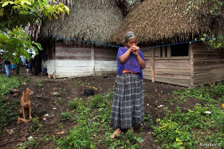 Elvira Choc, 59, grandmother of Jakelin Caal Maquin, a 7-year-old girl who died in U.S. custody, stands outside her house in Raxruha, Guatemala, Dec. 15, 2018.