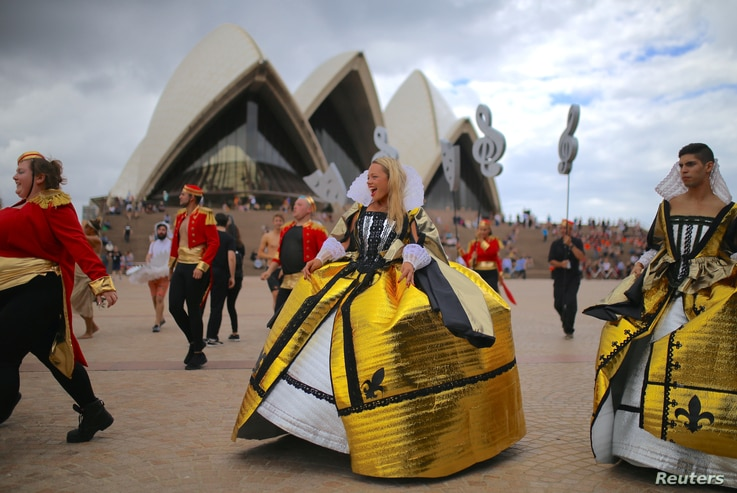 Members of the staff from the Sydney Opera House participate in a dress rehearsal in central Sydney, March 2, 2018, as part of preparations for their participation in the 40th anniversary of the Sydney Gay and Lesbian Mardi Gras Parade on Saturday.