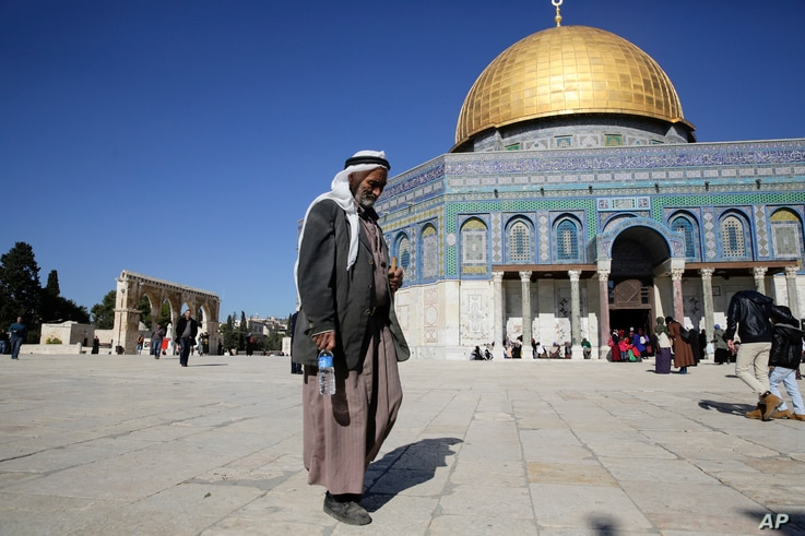 A Palestinian walks in front of the Dome of the Rock ahead of the prayers in Jerusalem, Dec. 8, 2017.
