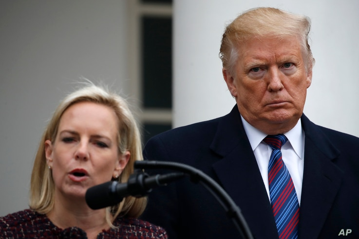 FILE - President Donald Trump listens as Homeland Security Secretary Kirstjen Nielsen speaks in the Rose Garden of the White House after a meeting with Congressional leaders on border security at the White House, Jan. 4, 2019.