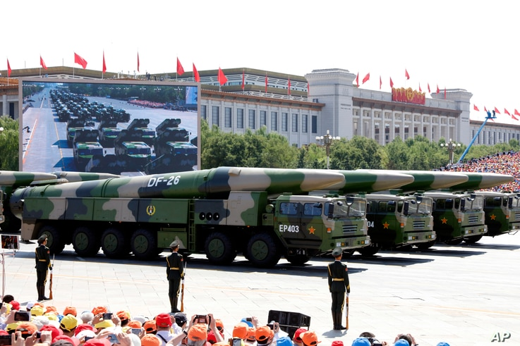 FILE - Military vehicles carry DF-26 medium-range ballistic missiles during a parade commemorating the 70th anniversary of Japan's surrender during World War II held in front of Tiananmen Gate in Beijing, Sept. 3, 2015. The spectacle involved more th...