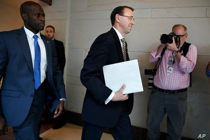 Deputy Attorney General Rod Rosenstein arrives on Capitol Hill in Washington for a closed-door meeting with Senators a day after appointing former FBI Director Robert Mueller to oversee the investigation into possible ties between Russia and Presiden...