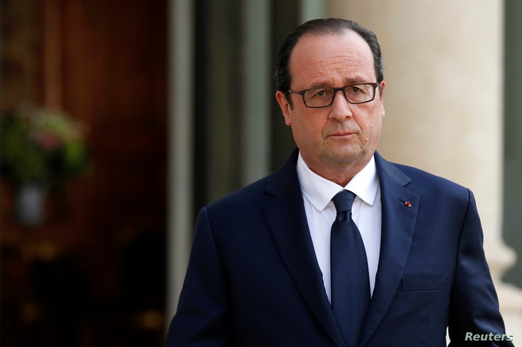 French President Francois Hollande holds a news conference after Air Algerie flight AH5017 crashed on Thursday en route from Ouagadougou in Burkina Faso to Algiers at the Elysee Palace in Paris, July 24, 2014.