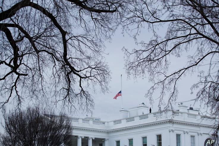 The flag above the White House is lowered to half-staff for the shooting victims of a mass shooting in a South Florida High School, Feb. 15, 2018, in Washington.