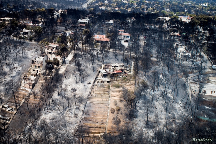 An aerial view shows burnt houses and trees following a wildfire in the village of Mati, near Athens, Greece, July 25, 2018. Antonis Nicolopoulos/Eurokinissi via REUTERS - ATTENTION EDITORS - THIS IMAGE WAS PROVIDED BY A THIRD PARTY. NO RESALES. NO A...