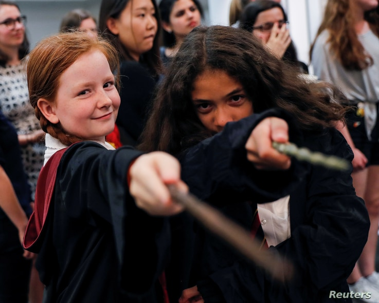 Harry Potter fans pose for a photograph at an anniversary presentation at Waterstones bookshop in London, Britain, June 26, 2017.