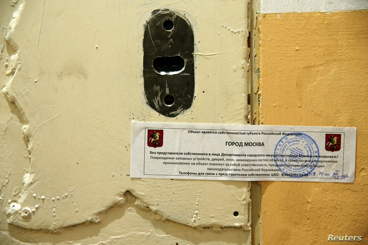 The office door of rights group Amnesty International is sealed off in Moscow, Russia, Nov. 2, 2016.