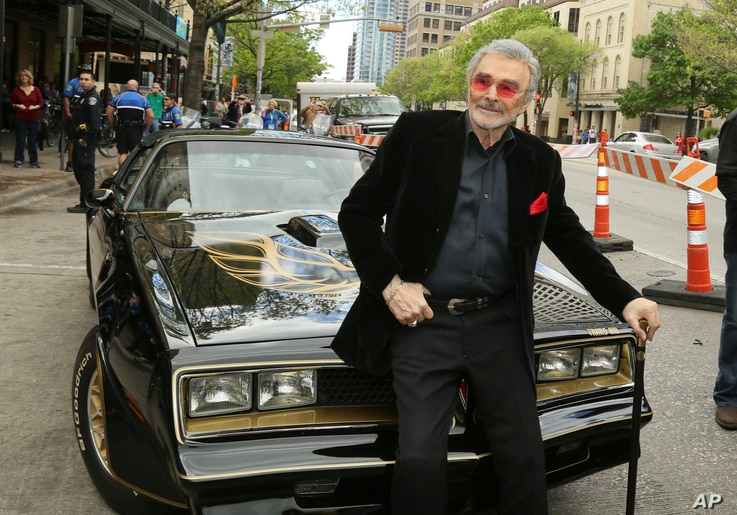 """FILE - In this March 12, 2016, file photo, Burt Reynolds sits on a 1977 Pontiac Trans-Am at the world premiere of """"The Bandit"""" at the Paramount Theatre during the South by Southwest Film Festival in Austin, Texas.  Hundreds of fans in Trans Ams made ..."""