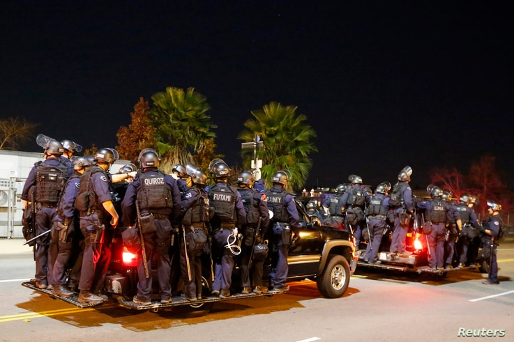 Police follow protesters during a march in Los Angeles, California, following Monday's grand jury decision in the shooting of Michael Brown in Ferguson, Missouri, November 25, 2014. U.S. President Barack Obama said on Tuesday anyone who destroys prop...