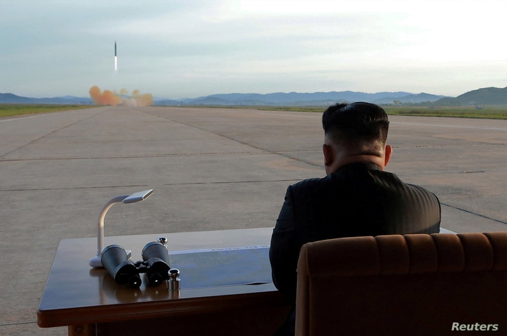 North Korean leader Kim Jong Un watches the launch of a Hwasong-12 missile in this undated photo released by North Korea's Korean Central News Agency (KCNA) on September 16, 2017. KCNA via REUTERS   ATTENTION EDITORS - THIS PICTURE WAS PROVIDED BY A ...