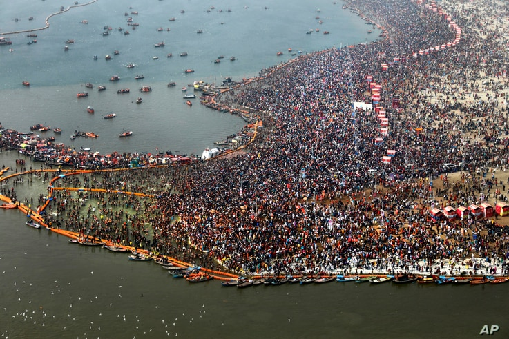 An Ariel view of thousands of Hindu devotees taking dips at Sangam, the confluence of three sacred rivers  the Yamuna, the Ganges and the mythical Saraswati, on Mauni Amavsya or the new moon day, the most auspicious day during the Kumbh Mela or the P