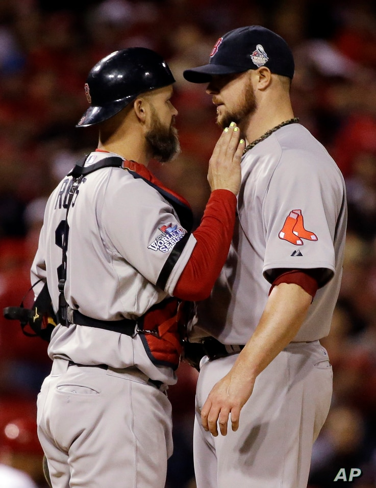 Boston Red Sox catcher David Ross talks to starting pitcher Jon Lester during the eighth inning of Game 5 of baseball's World Series against the St. Louis Cardinals Monday, Oct. 28, 2013, in St. Louis. (AP Photo/Jeff Roberson)
