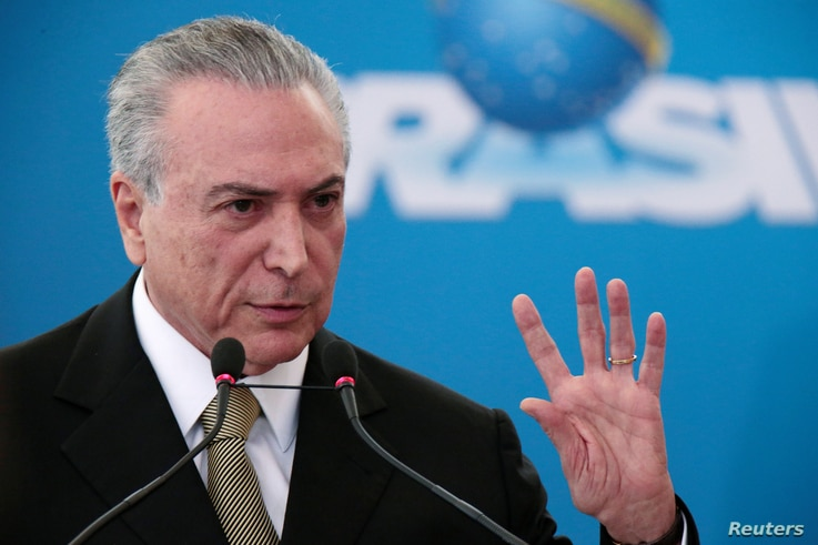 Brazil's interim President Michel Temer gestures during the inauguration ceremony of new presidents of state companies, at the Planalto Palace in Brasilia, June 1, 2016.