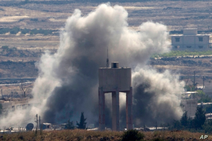 FILE - Smoke and explosions from fighting between forces loyal to Syrian President Bashar Assad and rebels in the Quneitra area of Syria are seen from the Israeli-occupied Golan Heights, June 17, 2015. The Russian military intervention to prop up the...