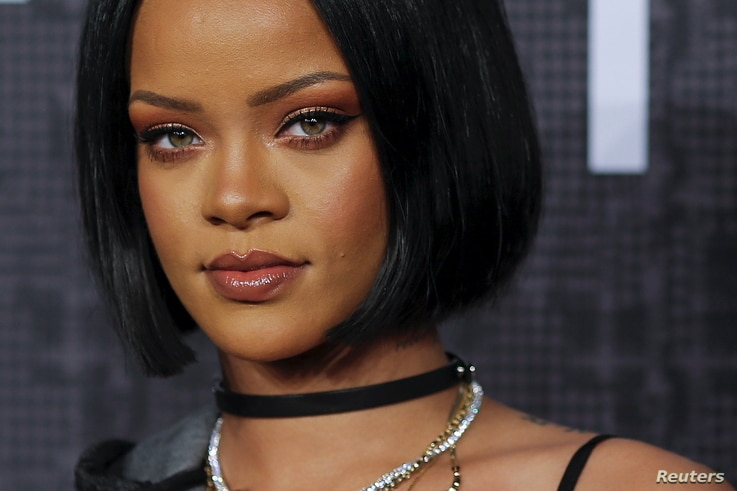 FILE - Singer Rihanna attends the red carpet before the Fenty PUMA by Rihanna Fall/Winter 2016 collection show during New York Fashion Week in New York.