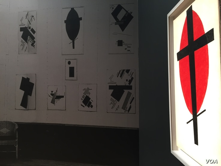 Kazimir Malevich, Mystic Suprematism (Black Cross on Red Oval), at the Sotheby's auction, New York, Nov. 5, 2015. (M. Lamon/VOA)