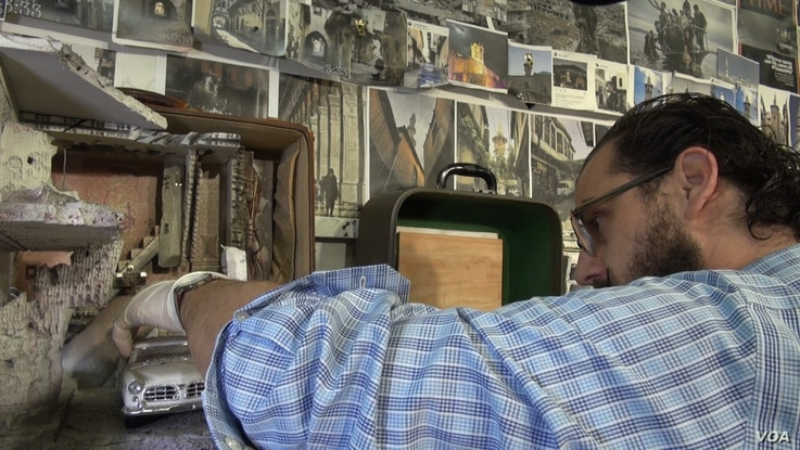 In his New Haven, CT, studio Hafez builds his miniatures with minute detail.