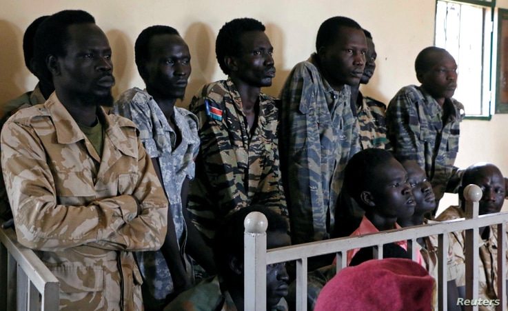 South Sudanese soldiers suspected of raping five foreign aid workers and killing their local colleague are seen before appearing in a military court in South Sudan's capital Juba, May 30, 2017.