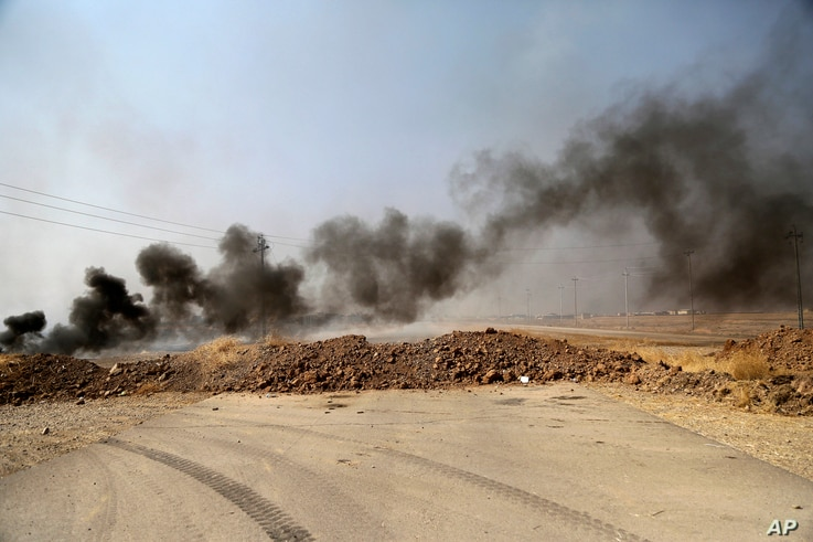 Smoke rises from Islamic state positions after an airstrike by coalition forces in villages surrounding Mosul, in Khazer, about 30 kilometers east of Mosul, Iraq, Oct. 17, 2016. Iraqi government and Kurdish forces, backed by U.S.-led coalition air an...