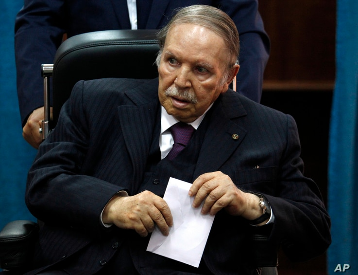 FILE - Algerian President Abdelaziz Bouteflika prepares to vote in Algiers, May 4, 2017.