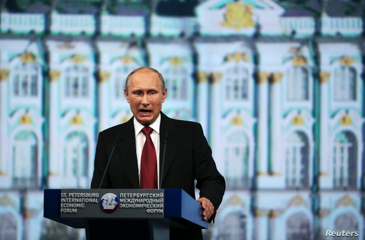Russia's President Vladimir Putin delivers a speech during a session of the St. Petersburg International Economic Forum 2014 (SPIEF 2014) in St. Petersburg May 23, 2014. Putin said on Friday he wanted better ties with the West but fiercely criticised