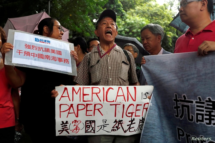 A protester from a local pro-China party chants slogans against the United States supporting an international court ruling that denied China's claims to the South China Sea, outside U.S. Consulate in Hong Kong, China July 14, 2016.