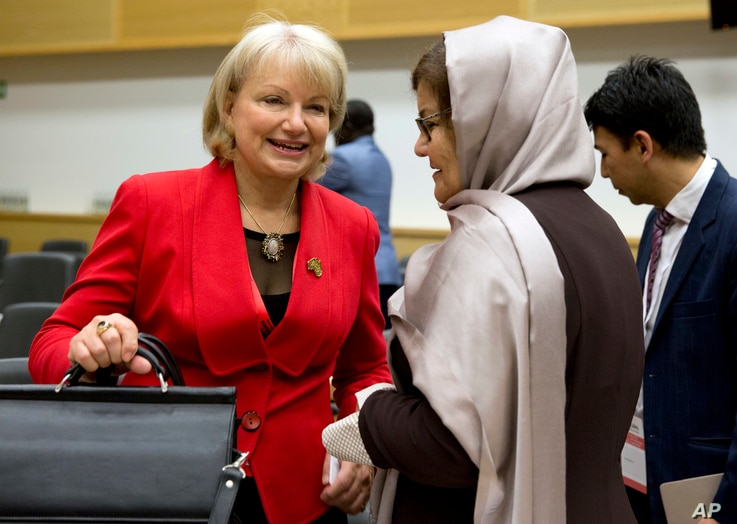 Australia's Ambassador for Women and Girls for the Department of Foreign Trade and Affairs, Sharman Stone (left)  speaks with Afghanistan's Minister for Women's Affairs Alhaj Delbar Nazari (center) as they attend the conference, She Decides, in Bruss...