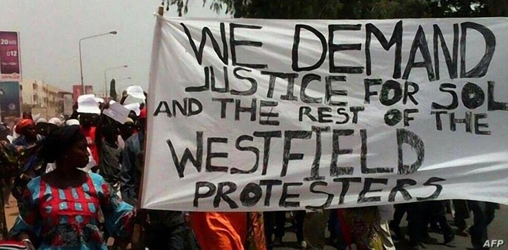 People demonstrate on April 16, 2016 in Banjul following the death of an opposition figure.  A senior figure in Gambia's main opposition has died in custody after leading a protest for electoral reform and the resignation of strongman President Yahya...