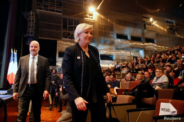 Marine Le Pen, National Front political party leader, attends a news conference, during the party's convention in Lille, France, March 10, 2018.