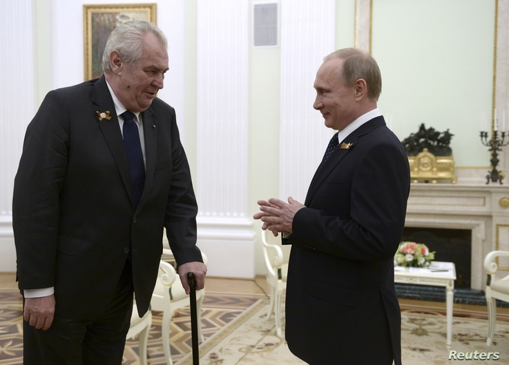 Czech Republic President Milos Zeman, left, talks to Russian President Vladimir Putin during their meeting at the Kremlin in Moscow, May 9, 2015.