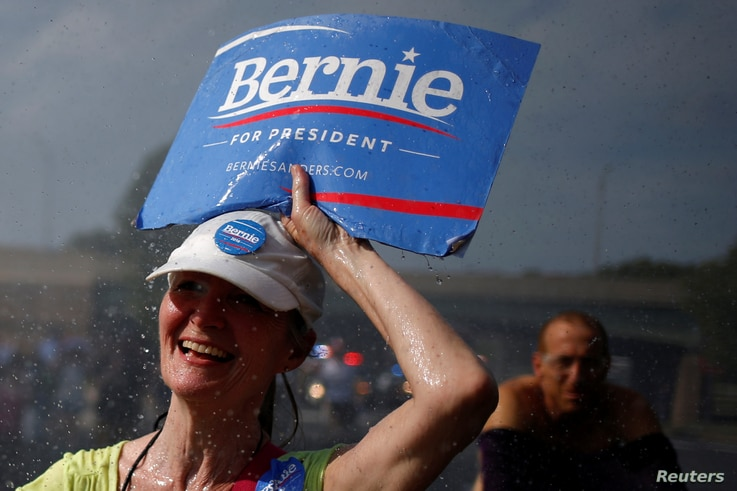 A supporter of U.S. Senator Bernie Sanders walks past a water hydrant during a protest march ahead of the 2016 Democratic National Convention in Philadelphia, Pennsylvania, July 24, 2016.