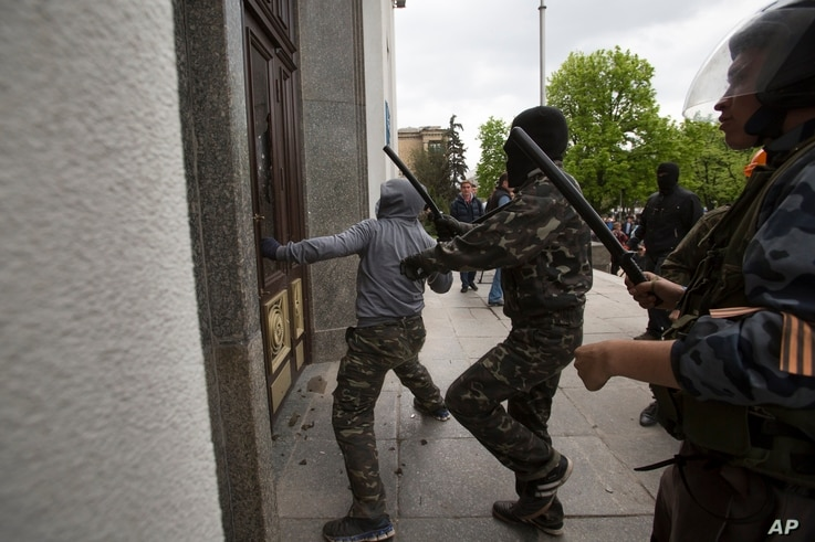 Pro-Russian activists storm an administration building in the center of Luhansk, Ukraine, one of the largest cities in Ukraine's troubled east, April 29, 2014.
