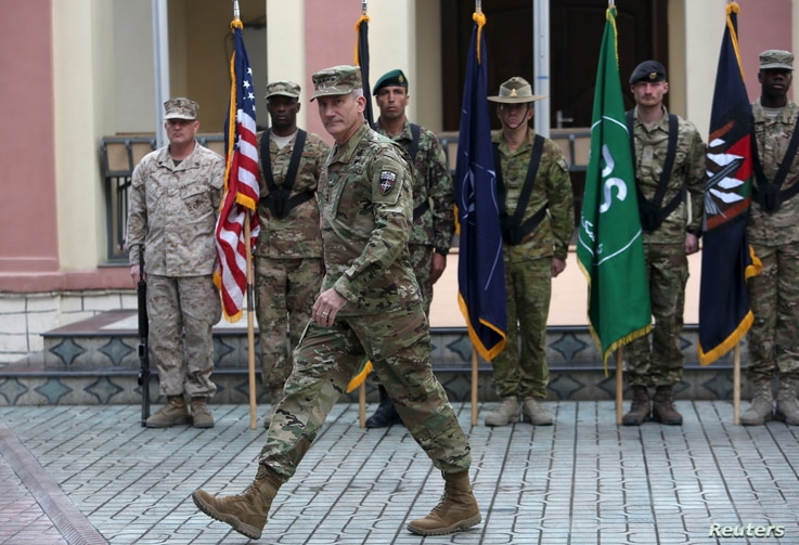 U.S. Army General John Nicholson strides onstage during a ceremony welcoming him as the new commander of NATO and U.S. forces in Afghanistan, in Kabul, March 2, 2016.