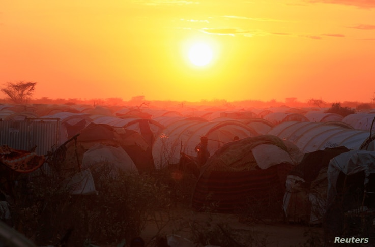 FILE - The sun sets over the Ifo extension refugee camp in Dadaab, near the Kenya-Somalia border, in Garissa County, Kenya, July 31, 2011.