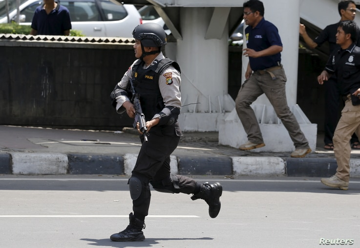 An Indonesian policeman runs near the site of a blast in Jakarta, Indonesia, Jan. 14, 2016.