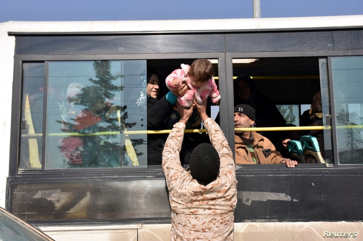 People who fled the Shi'ite Muslim villages of al-Foua and Kefraya arrive in government-controlled Jibreen area in Aleppo, Syria, in this handout picture provided by SANA on Dec. 19, 2016.