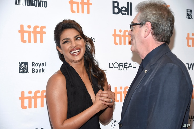 Actress Priyanka Chopra, left, chats with the director and CEO of TIFF Piers Handling at the TIFF Soiree, an annual fundraiser and celebratory kick-off for the 2017 Toronto International Film Festival, at the TIFF Bell Lightbox, Sept. 6, 2017, in Tor...