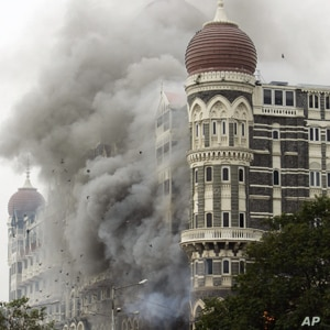 In this Saturday, Nov. 29, 2008 file picture, smoke billows from the landmark Taj Mahal hotel in Mumbai, India after an attack by gunmen.