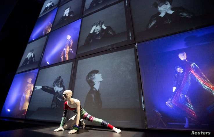 """A striped asymmetric catsuit by Yansai Yamamoto (1973), used by performer David Bowie on his Aladdin Sane tour, is seen at the """"David Bowie is"""" Exhibition at the Victoria and Albert Museum in London, March 20, 2013."""