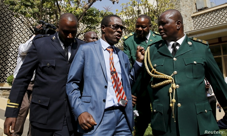 Kenyan Member of Parliament for Ugujna Constituency Opiyo Wandayi (C) is ejected from the National Assembly for blowing whistles during President Uhuru Kenyatta's annual State of the Nation address at the Parliament Buildings in Nairobi, March 31, 20...