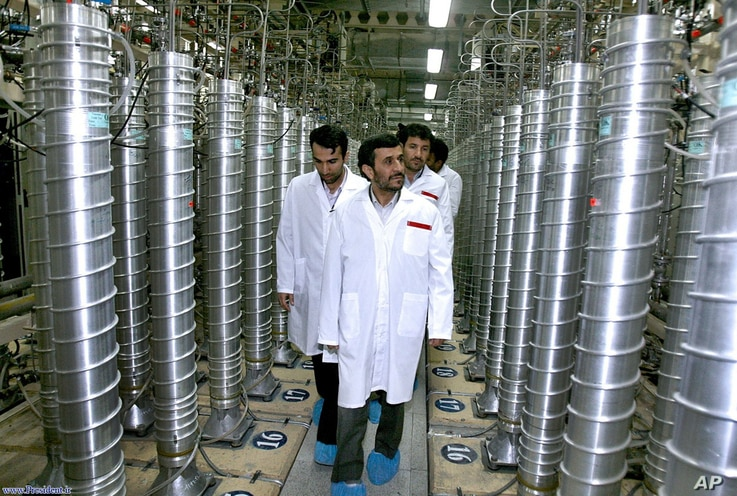 In this photo released by the Iranian President's Office, Iranian President Mahmoud Ahmadinejad, center, visits the Natanz Uranium Enrichment Facility some 200 miles (322 kilometers) south of the capital Tehran, Iran, April 8, 2008.