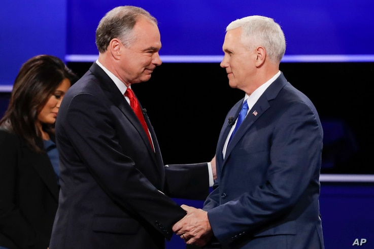 Republican vice-presidential nominee Gov. Mike Pence, right, and Democratic vice-presidential nominee Sen. Tim Kaine shake hands during the vice-presidential debate at Longwood University in Farmville, Va.