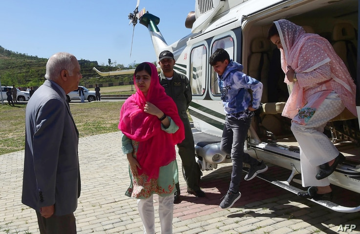 Pakistani activist and Nobel Peace Prize laureate Malala Yousafzai, center, meets with the principal, second left, of all-boys Swat Cadet College Guli Bagh, upon her arrival during her hometown visit, 15 kilometers outside of Mingora, March 31, 2018....