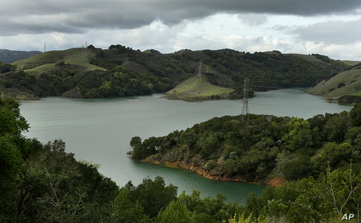 Briones Reservoir is seen near capacity in Orinda, California, Jan. 11, 2017. A stunning transformation was caused by an unrelenting series of storms in the North that filled lakes, overflowed rivers and buried mountains in snow.