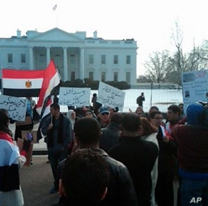 Demonstrators shout anti-Mubarak slogans in front of the White House, January 30, 2011
