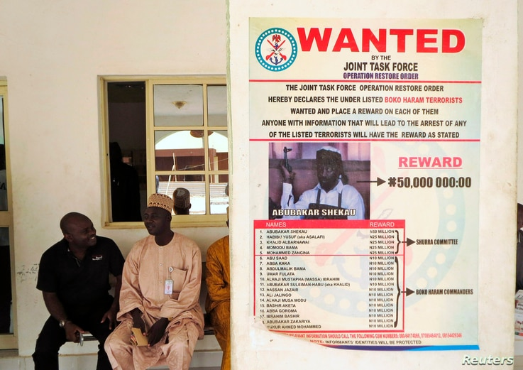 A poster advertising for the search of Boko Haram leader Abubakar Shekau is pasted on a wall in Baga village on the outskirts of Maiduguri, in the north-eastern state of Borno, Nigeria, May 13, 2013.