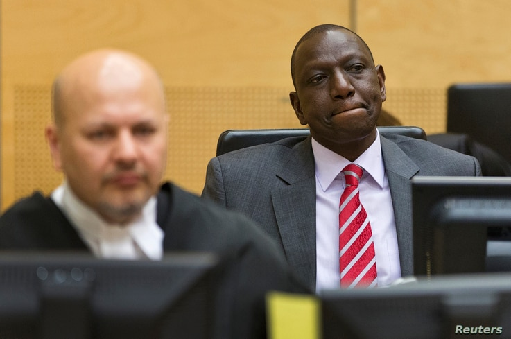 Kenya's Deputy President William Ruto (R) reacts as he sits in the courtroom before his trial at the International Criminal Court (ICC) in The Hague, Sept. 10, 2013.