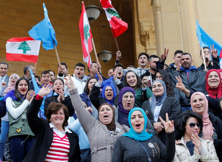 Supporters of Saad al-Hariri, who suspended his decision to resign as prime minister, hold flags and chant slogans near Martyrs' Square in downtown Beirut, Lebanon, Nov. 22, 2017.