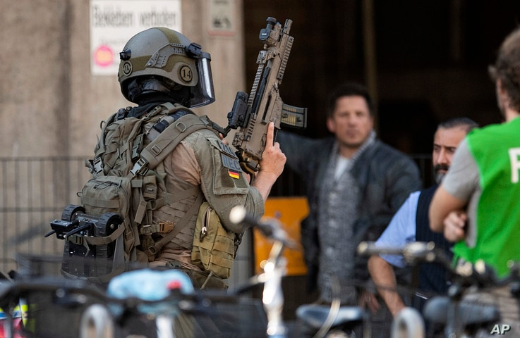 Special police operate take position near the Cologne, western Germany,  train station Oct. 15, 2018.