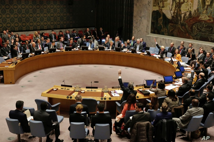 FILE - The U.N. Security Council votes on a resolution concerning North Korea, March 23, 2017. The council on April 6 condemned Pyongyang for its latest missile test.